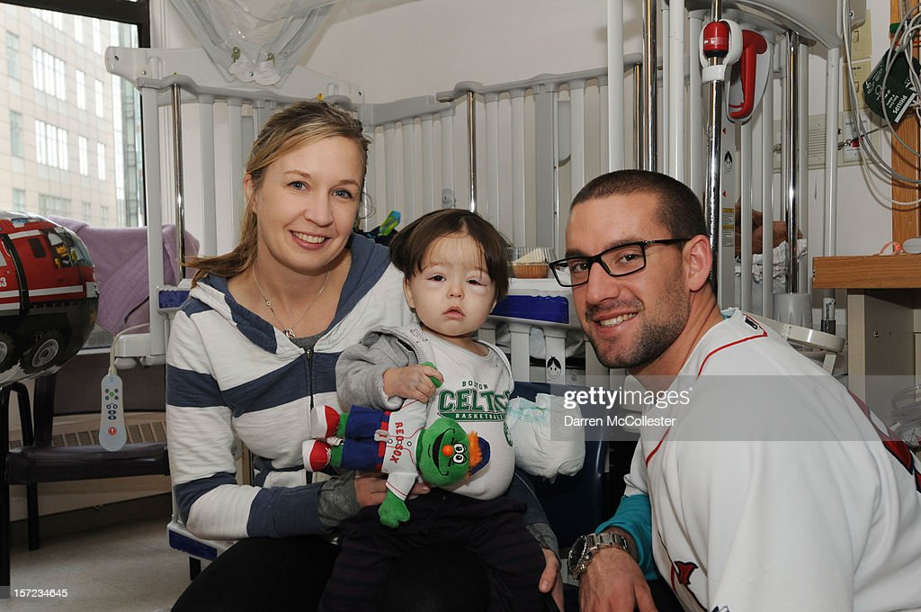 Ryan Kalish of the Boston Red Sox visits Conor and his mother at Boston Children's Hospital on November 30, 2012 in Boston, Massachusetts.