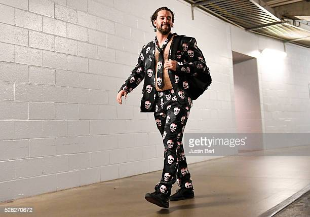 Ryan Kalish of the Chicago Cubs exit the stadium while taking part in the Cubs Zany Suit roadtrip after playing the Pittsburgh Pirates at PNC Park on...