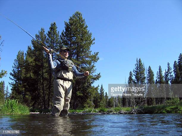 Ryan Kamp of Chicago fishes for brook and rainbow trout in the Deschutes River upstream from Crane Prairie Reservoir in Oregon