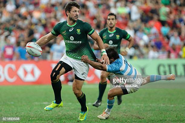 Ryan Kankowski of South Africa is tackled by Nicolas Bruzzone of Argentina in the 2016 Singapore Sevens Cup 3rd and 4th placing between Argentina and...