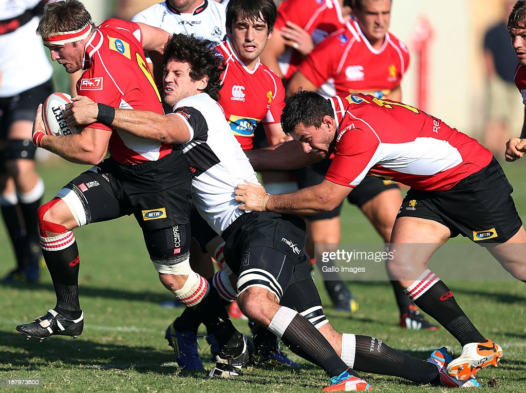 <a gi-track='captionPersonalityLinkClicked' href=/galleries/search?phrase=Ryan+Kankowski&family=editorial&specificpeople=804518 ng-click='$event.stopPropagation()'>Ryan Kankowski</a> of the Sharks looks to tackle Jaco Kriel of the during the Vodacom Cup quarter final match between Sharks XV and MTN Golden Lions at Kings Park on May 03, 2013 in Durban, South Africa.