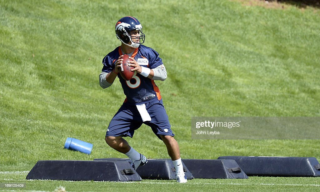ENGLEWOOD, CO. - Ryan Katz (8) of the Denver Broncos runs through drills during the teams OTAs May 20, 2013 at Dove Valley. All offseason training activities (OTAs) are voluntary until the mandatory minicamp June 11-13.