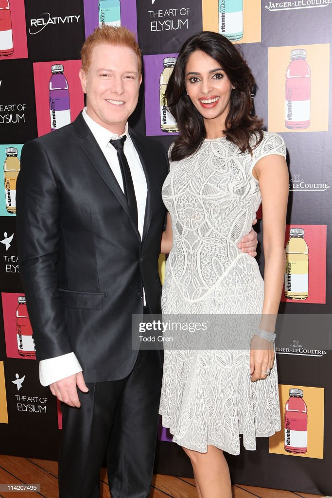 Ryan Kavanaugh and Mallika Sherawat attend the Art Of Elysium 3rd Annual Paradis Event hosted by vitaminwater at Hotel Du Cap on May 15, 2011 in Antibes, France.
