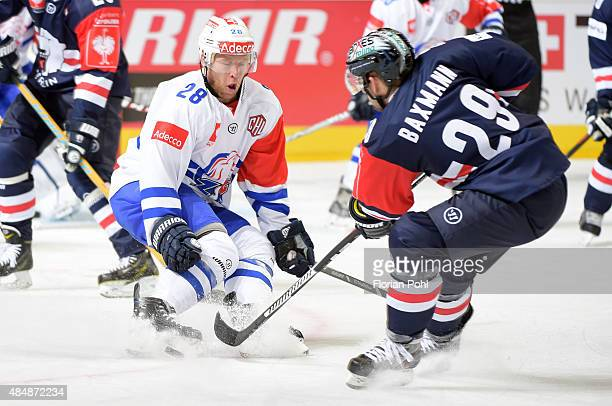 Ryan Keller of ZSC Lions Zuerich and Jens Baxmann of the Eisbaeren Berlin fight for the puck during the game between Eisbaeren Berlin and ZSC Lions...