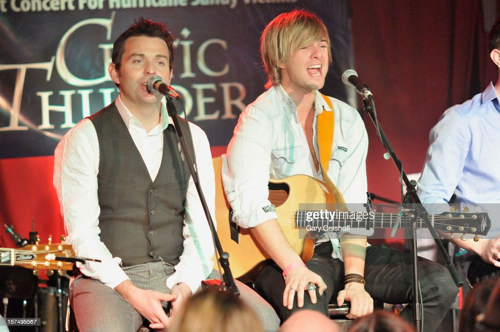 Ryan Kelly (L) and Keith Harkin of Celtic Thunder perform during an unplugged concert benefitting Hurricane Sandy victims at Sullivan Hall on December 3, 2012 in New York City.