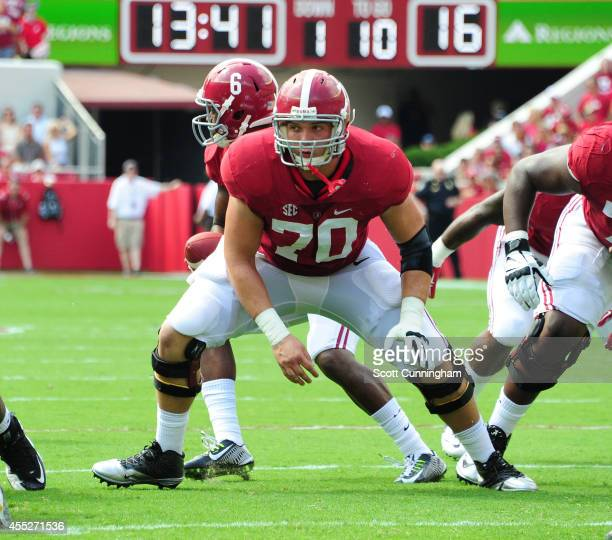 Ryan Kelly of the Alabama Crimson Tide blocks against the Florida Atlantc Owls on September 6 2014 at BryantDenny Stadium in Tuscaloosa Alabama