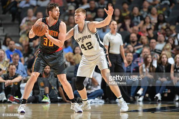 Ryan Kelly of the Atlanta Hawks handles the ball against Davis Bertans of the San Antonio Spurs on October 8 2016 at the ATT Center in San Antonio...