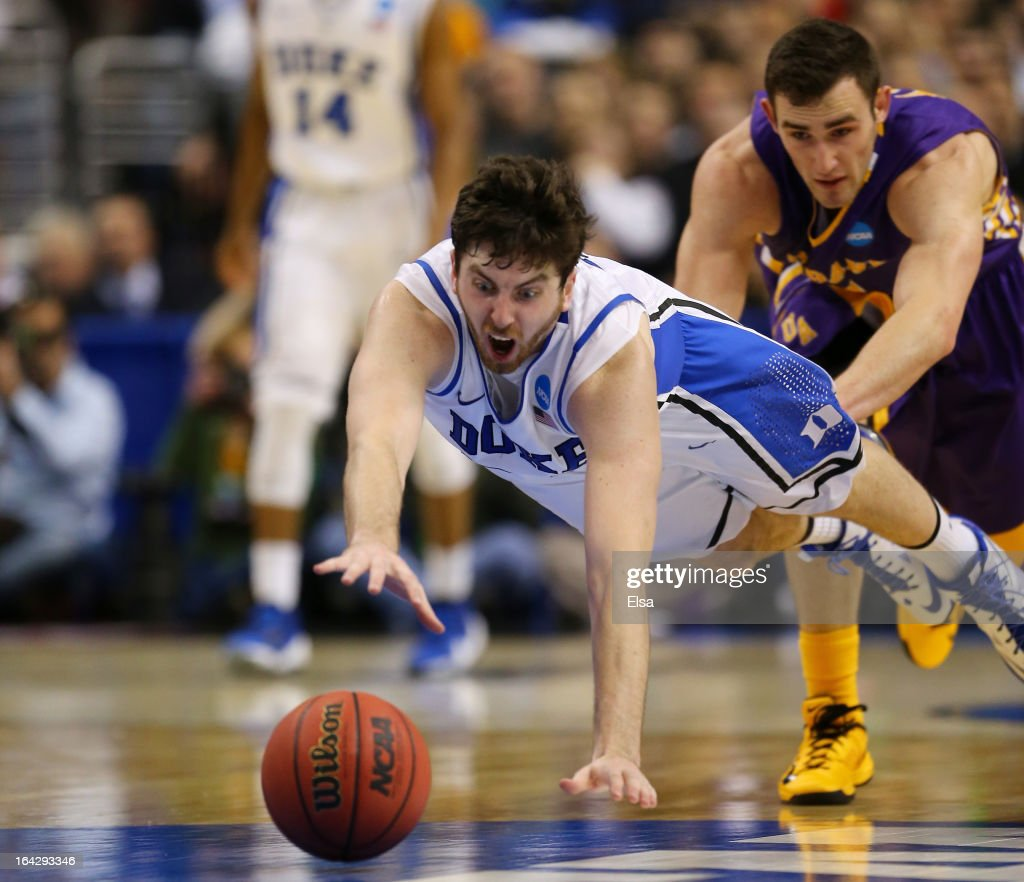 Ryan Kelly #34 of the Duke Blue Devils dives for a loose ball in the second half while taking on the Albany Great Danes during the second round of the 2013 NCAA Men's Basketball Tournament on March 22, 2013 at Wells Fargo Center in Philadelphia, Pennsylvania.
