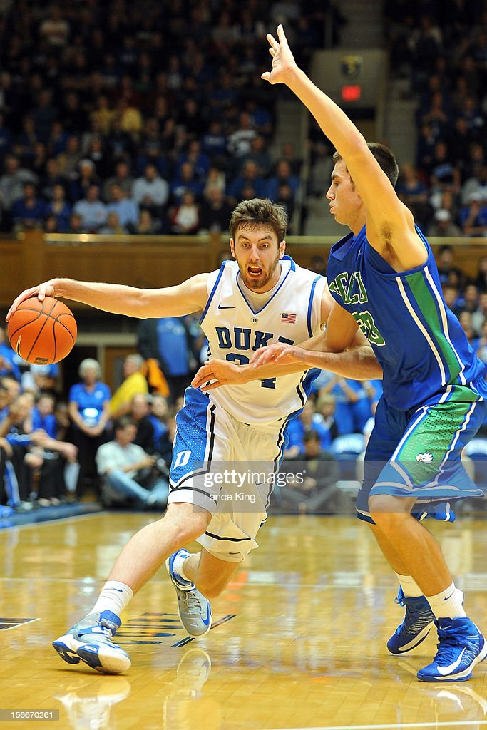 Ryan Kelly #34 of the Duke Blue Devils dribbles against Chase Fieler #20 of the Florida Gulf Coast Eagles at Cameron Indoor Stadium on November 18, 2012 in Durham, North Carolina.