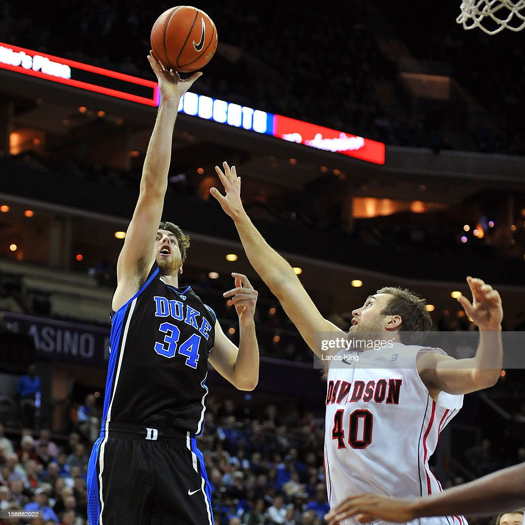 Ryan Kelly #34 of the Duke Blue Devils puts up a shot against Clint Mann #40 of the Davidson Wildcats at Time Warner Cable Arena on January 2, 2013 in Charlotte, North Carolina.