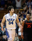 Ryan Kelly of the Duke Blue Devils reacts after making a basket during their game against the Miami Hurricanes at Cameron Indoor Stadium on March 2...