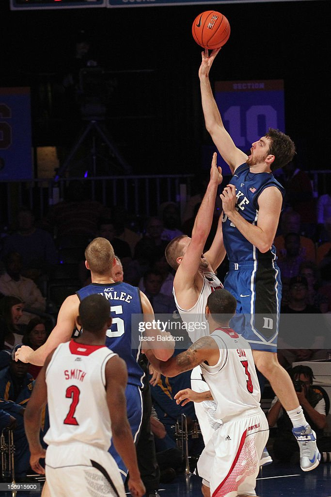 <a gi-track='captionPersonalityLinkClicked' href=/galleries/search?phrase=Ryan+Kelly+-+Basketball+Player&family=editorial&specificpeople=15185169 ng-click='$event.stopPropagation()'>Ryan Kelly</a> #34 of the Duke Blue Devils shoots over Luke Hancock #11 of the Louisville Cardinals during the Battle 4 Atlantis tournament at Atlantis Resort November 24, 2012 in Nassau, Paradise Island, Bahamas.