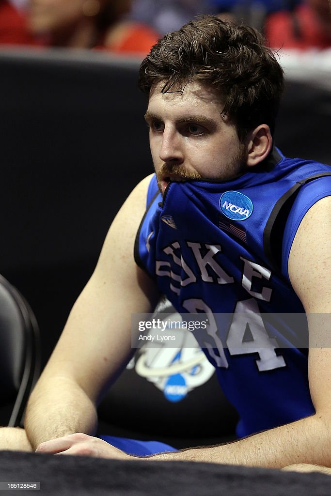 Ryan Kelly #34 of the Duke Blue Devils sits on the bench dejected as they lost to the Louisville Cardinals 85-63 during the Midwest Regional Final round of the 2013 NCAA Men's Basketball Tournament at Lucas Oil Stadium on March 31, 2013 in Indianapolis, Indiana.