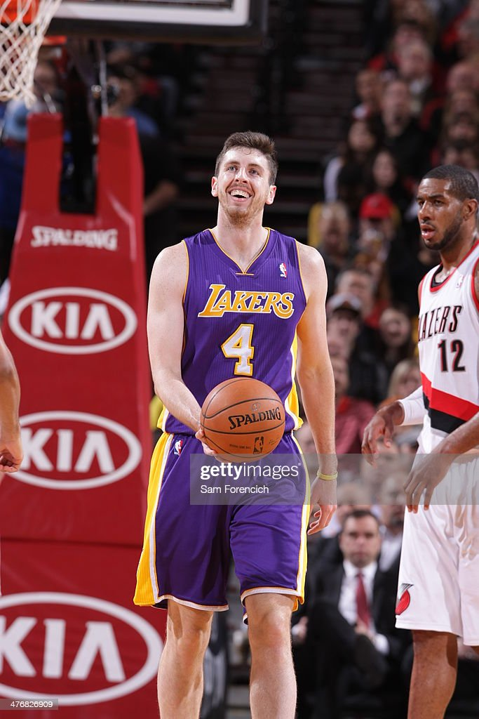 <a gi-track='captionPersonalityLinkClicked' href=/galleries/search?phrase=Ryan+Kelly+-+Basketball+Player&family=editorial&specificpeople=15185169 ng-click='$event.stopPropagation()'>Ryan Kelly</a> #4 of the Los Angeles Lakers walks up court against the Portland Trail Blazers on March 3, 2014 at the Moda Center Arena in Portland, Oregon.