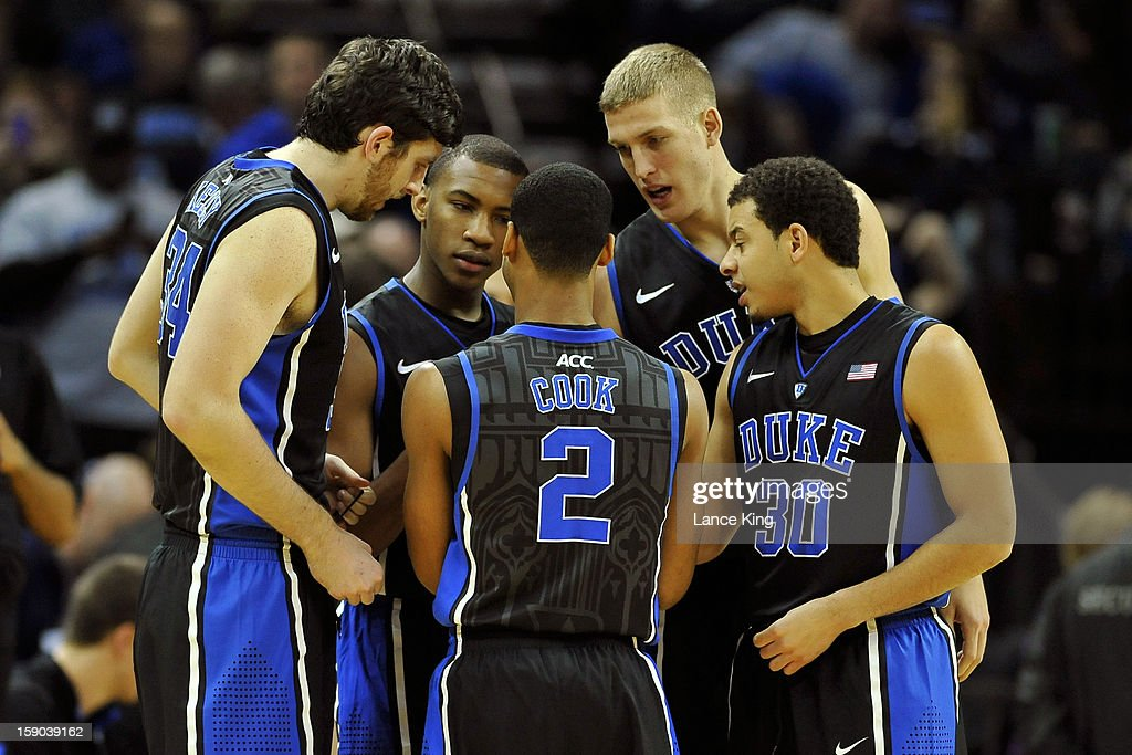 Ryan Kelly #34, Rasheed Sulaimon #14, Quinn Cook #2, Mason Plumlee #5 and Seth Curry #30 of the Duke Blue Devils huddle during a game against the Davidson Wildcats at Time Warner Cable Arena on January 2, 2013 in Charlotte, North Carolina. Duke defeated Davidson 67-50.