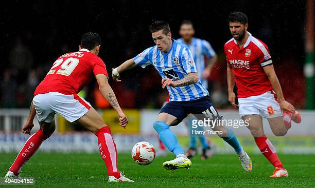 Ryan Kent of Coventry City looks to break past Raphael Rossi Branco of Swindon Town during the Sky Bet League One match between Swindon Town and...