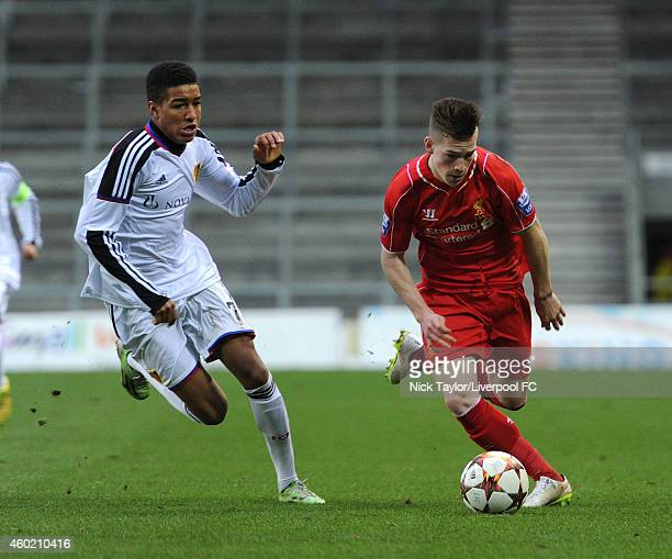 Ryan Kent of Liverpool and Charles Pickel of FC Basel in action during the UEFA Youth League fixture between Liverpool and FC Basel at Langtree Park...