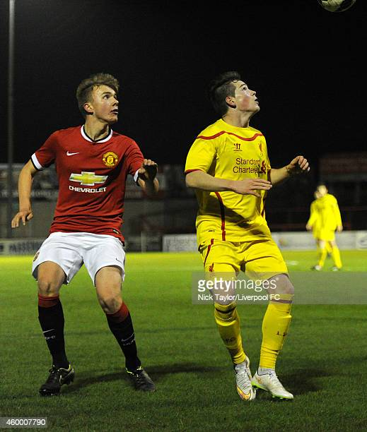 Ryan Kent of Liverpool and Charlie Scott of Manchester United in action during the Barclays Premier League Under 18 fixture between Manchester United...