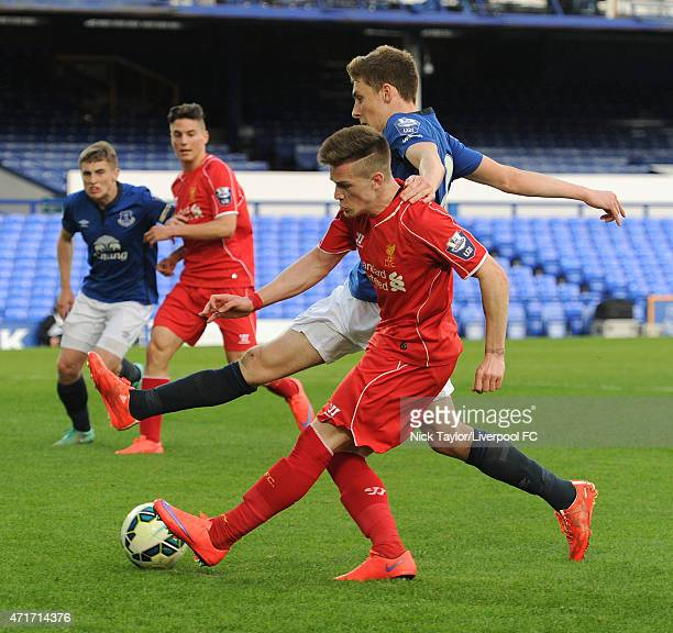 Ryan Kent of Liverpool and Joe Williams of Everton in action during the U21 Premier League match between Everton and Liverpool at Goodison Park on...