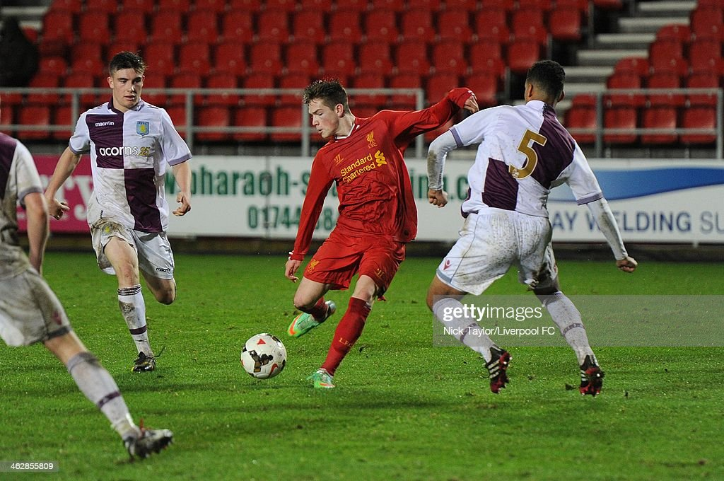 Ryan Kent of Liverpool and Kevin Toner and Kodi Lyons-Foster (5) of Aston Villa during the FA Youth Cup Fourth Round fixture between Liverpool and Aston Villa at Langtree Park on January 15, 2014 in St Helens, England.