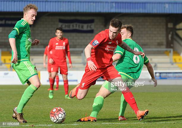 Ryan Kent of Liverpool and Rees Greenwood and Martin Smith of Sunderland in action during the Liverpool v Sunderland Barclays U21 Premier League game...