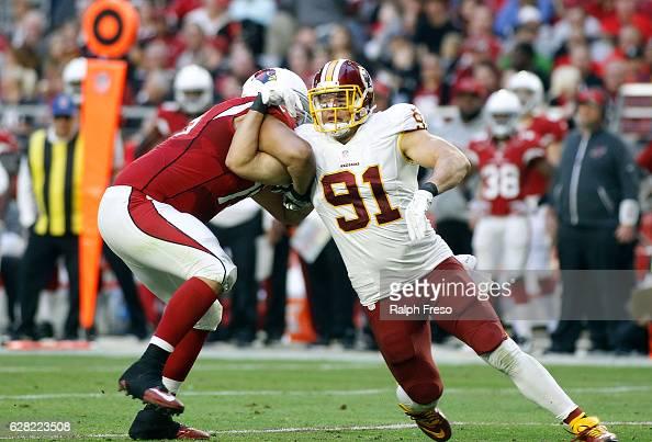 Ryan Kerrigan of the Washington Redskins battles through the block of John Ulrick of the Arizona Cardinals during the third quarter of a game at...