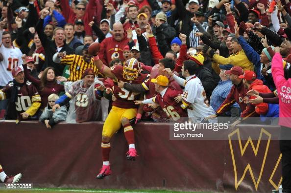 Ryan Kerrigan of the Washington Redskins celebrates his interception in for a touchdown against the Atlanta Falcons at FedExField on October 7 2012...