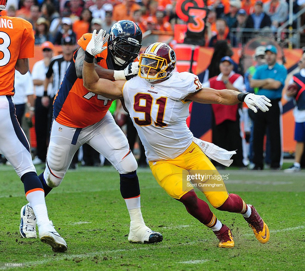Ryan Kerrigan of the Washington Redskins rushes the passer against Orlando Franklin of the Denver Broncos at Sports Authority Field on October 27...