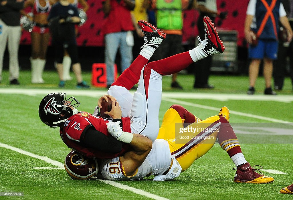 Ryan Kerrigan of the Washington Redskins sacks Matt Ryan of the Atlanta Falcons at the Georgia Dome on October 11 2015 in Atlanta Georgia