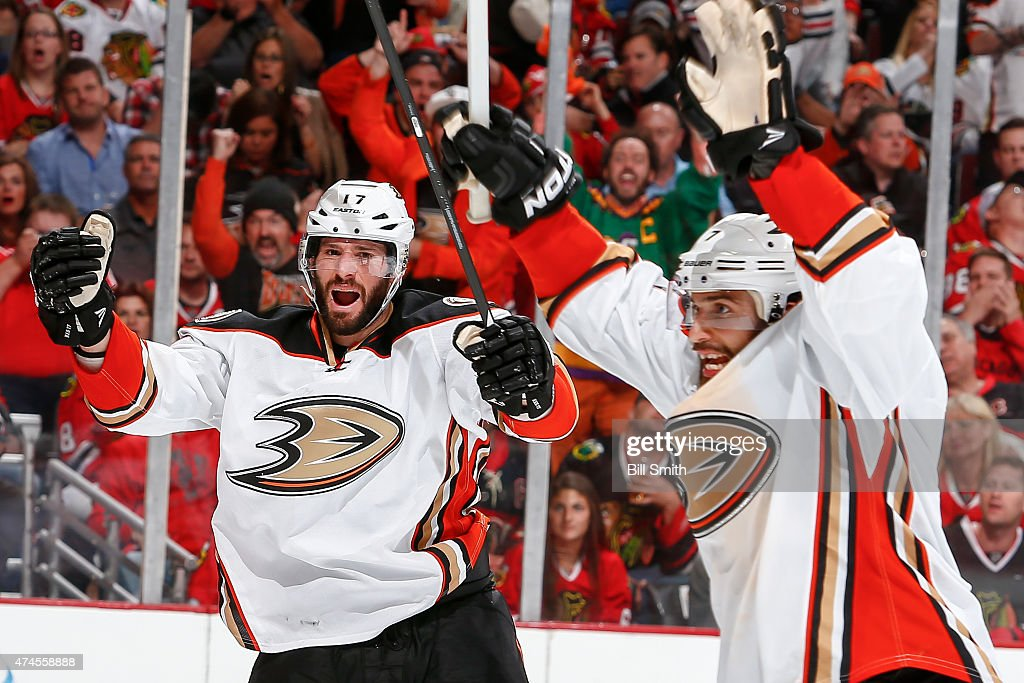 Ryan Kesler and Andrew Cogliano of the Anaheim Ducks react after Kesler scored against the Chicago Blackhawks in the third period in Game Four of the...
