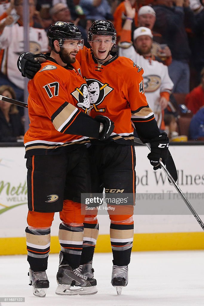 Ryan Kesler #17 and Josh Manson #42 of the Anaheim Ducks react after a goal during the second period of a game against the Calgary Flames at Honda Center on February 21, 2016 in Anaheim, California.
