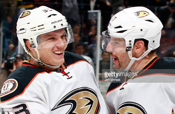 Ryan Kesler congratulates Jakob Silfverberg of the Anaheim Ducks who scored the shootout winning goal against the Vancouver Canucks during their NHL...