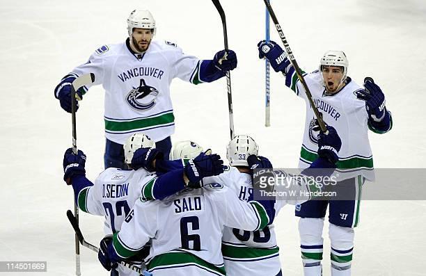 Ryan Kesler Daniel Sedin Sami Salo Henrik Sedin and Alex Burrows of the Vancouver Canucks celebrate Salo's second goal of the second period in Game...