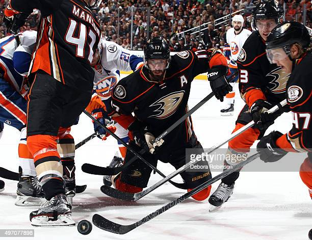 Ryan Kesler Jakob Silfverberg and Hampus Lindholm of the Anaheim Ducks vie for the puck against the New York Islanders on November 13 2015 at Honda...
