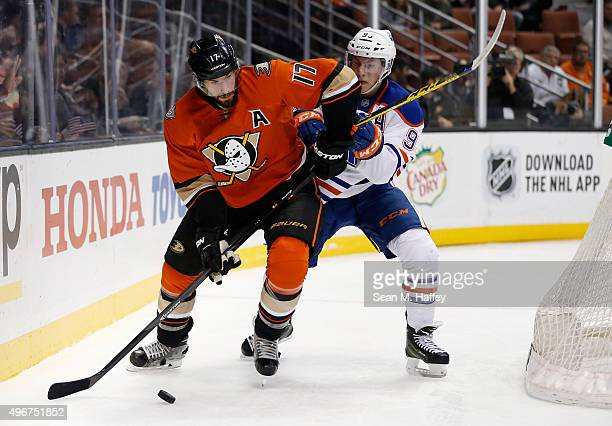 Ryan Kesler of the Anaheim Ducks and Ryan NugentHopkins of the Edmonton Oilers battle for a loose puck during the first period of a game at Honda...