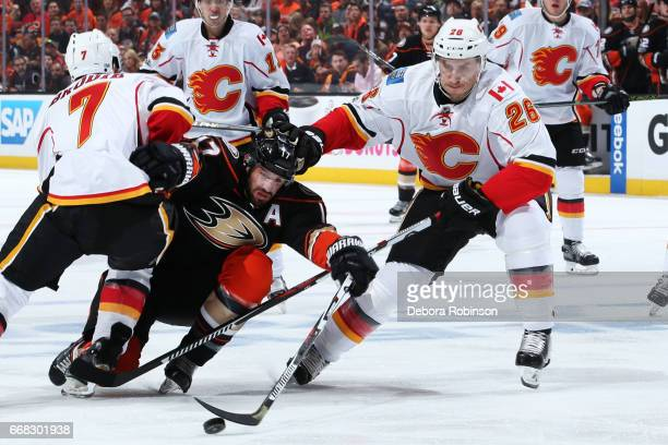 Ryan Kesler of the Anaheim Ducks battles for the puck against Michael Stone and TJ Brodie of the Calgary Flames in Game One of the Western Conference...