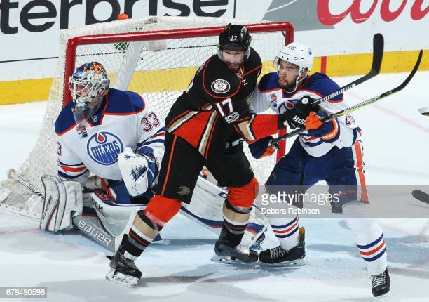 Ryan Kesler of the Anaheim Ducks battles in front of the net against Darnell Nurse and Cam Talbot of the Edmonton Oilers in Game Five of the Western...