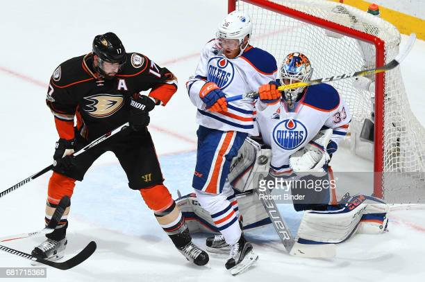 Ryan Kesler of the Anaheim Ducks battles in front of the net against Drake Caggiula and Cam Talbot of the Edmonton Oilers in Game Seven of the...