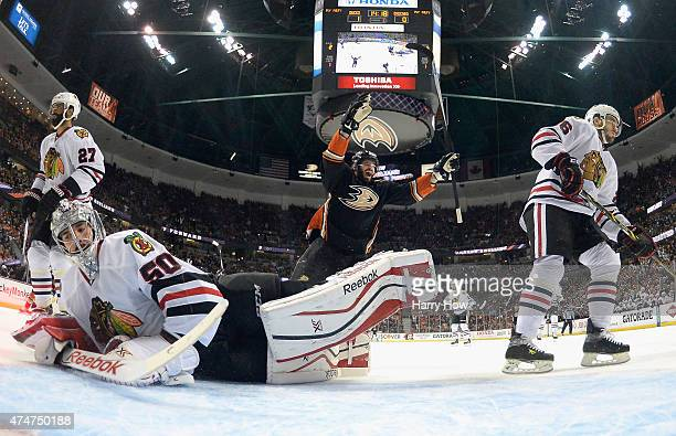 Ryan Kesler of the Anaheim Ducks celebrates his first period goal as goaltender Corey Crawford Kyle Cumiskey and Johnny Oduya of the Chicago...