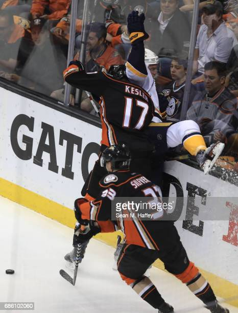 Ryan Kesler of the Anaheim Ducks checks Calle Jarnkrok of the Nashville Predators into the end board in the first period of Game Five of the Western...