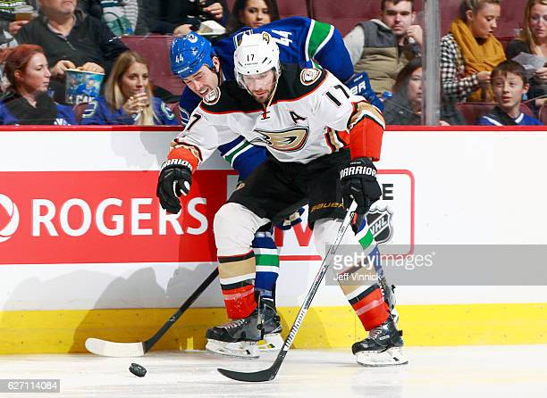 Ryan Kesler of the Anaheim Ducks checks Erik Gudbranson of the Vancouver Canucks during their NHL game at Rogers Arena December 1 2016 in Vancouver...