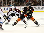 Ryan Kesler of the Anaheim Ducks controls the puck against Gabriel Landeskog of the Colorado Avalanche at Honda Center on April 3 2015 in Anaheim...