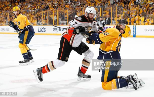 Ryan Kesler of the Anaheim Ducks cross checks Vernon Fiddler of the Nashville Predators in the mouth in Game Six of the Western Conference Final...