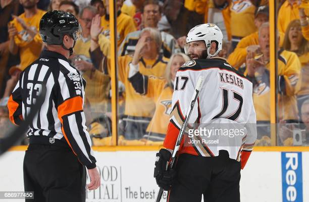 Ryan Kesler of the Anaheim Ducks glares at referee Kevin Pollock as he skates to the penalty box for an interference call against the Nashville...