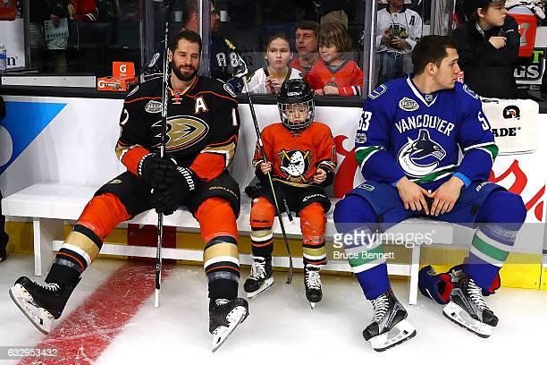 Ryan Kesler of the Anaheim Ducks his son Ryker Kesler and Bo Horvat of the Vancouver Canucks take a break during the 2017 Coors Light NHL AllStar...