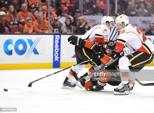 Ryan Kesler of the Anaheim Ducks is checked as he attempts to split the defense of TJ Brodie and Michael Stone of the Calgary Flames during the first...