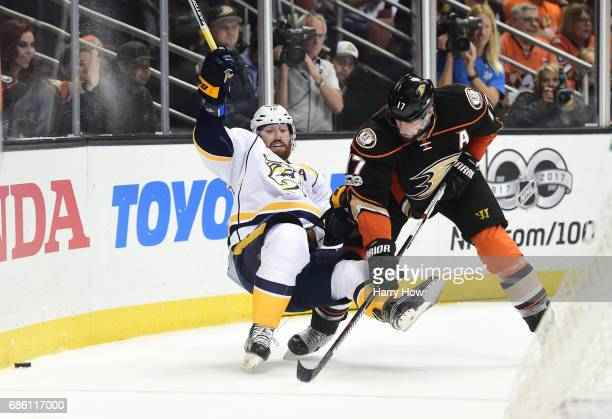 Ryan Kesler of the Anaheim Ducks knocks James Neal of the Nashville Predators off his skates in the second period of Game Five of the Western...