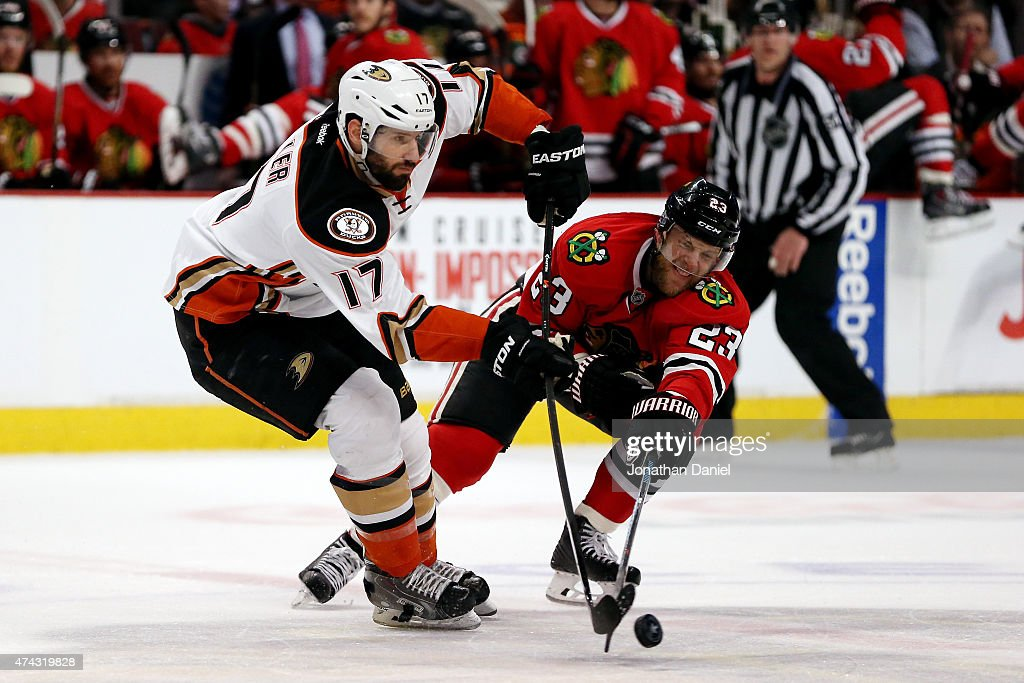 <a gi-track='captionPersonalityLinkClicked' href=/galleries/search?phrase=Ryan+Kesler&family=editorial&specificpeople=206915 ng-click='$event.stopPropagation()'>Ryan Kesler</a> #17 of the Anaheim Ducks passes the puck as <a gi-track='captionPersonalityLinkClicked' href=/galleries/search?phrase=Kris+Versteeg&family=editorial&specificpeople=2242969 ng-click='$event.stopPropagation()'>Kris Versteeg</a> #23 of the Chicago Blackhawks defends in Game Three of the Western Conference Finals during the 2015 NHL Stanley Cup Playoffs at the United Center on May 21, 2015 in Chicago, Illinois.