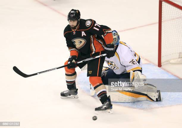 Ryan Kesler of the Anaheim Ducks sets up for the screened deflection in front of goaltender Pekka Rinne of the Nashville Predators in the first...