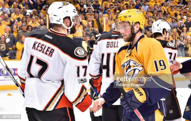 Ryan Kesler of the Anaheim Ducks shakes hands with Calle Jarnkrok of the Nashville Predators after the Predators defeated the Ducks 6 to 3 in Game...